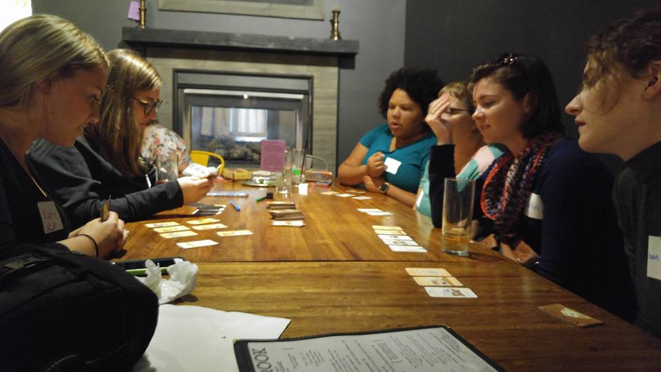Learn a Game Night - group of women playing Munchkin